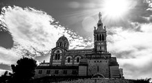Low Angle View Of Notre Dame De La Garde Against Sky On Sunny Day