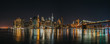 Panoramic view of Manhattan Bridge and Lower Manhattan Financial Disctrict at night with long exposure