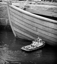 Close-up Of Boat Model By Cropped Moored Nautical Vessel
