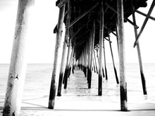 View Of Underneath Pier At Beach
