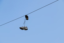 Shoes Hanging From A Telephone...