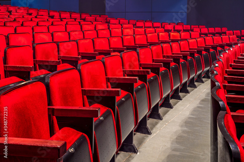 Empty Red Chairs In Auditorium Canvas Print