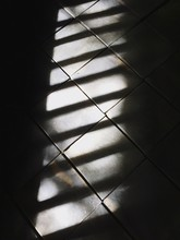Close-up Of Shadows On Tiled Wall