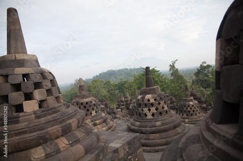 Fotografia Stupas At Borobudur Temple Against Sky