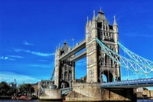 Low Angle View Of Tower Bridge Against Blue Sky