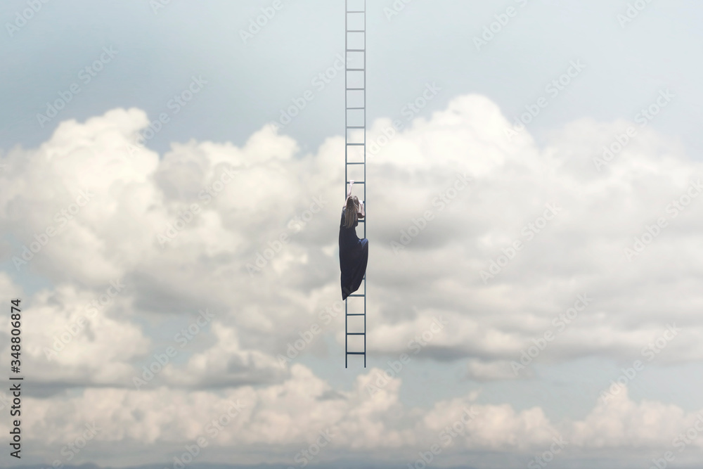 Fototapeta woman in search of freedom climbs a surreal staircase that descends from the sky