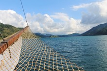 Boat With Fishing Net On Lake