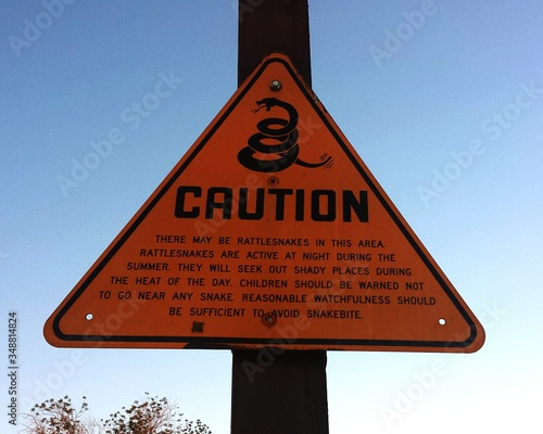 Beware Of Snakes Sign Board Against Clear Sky Canvas Print
