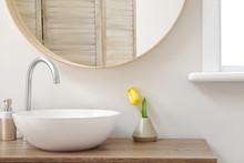 Interior Of Bathroom With Fresh Tulip Flower