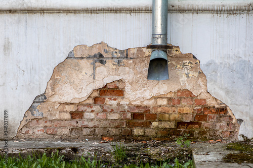 Vászonkép drainpipe near an old brick wall. Drainage from the building