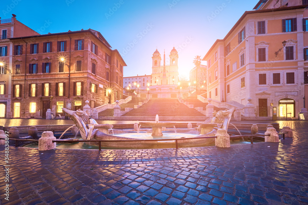 Fototapeta Monumental staircase Spanish Steps and and Trinita dei Monti church, sunrise, dawn, early morning view with Sun flare from Piazza di Spagna in Rome, Italy