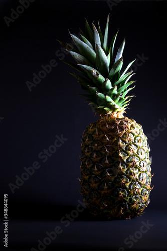 Fototapety, obrazy: pineapple on a black background. exotic fruit. breakfast