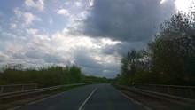 Highway Under Cloudy Sky