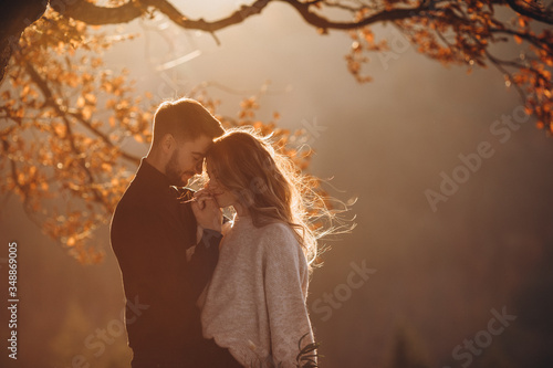 Stylish young couple in the autumn mountains Wallpaper Mural
