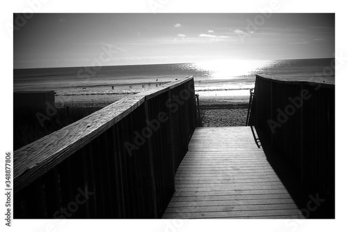 Canvas Print Footbridge Leading Towards Sea Against Sky