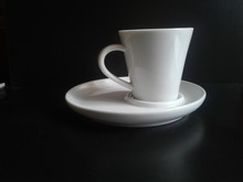 White Coffee Cup And Saucer On...