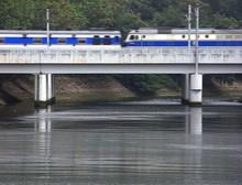 Train Moving On Railroad Bridge Over River