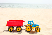 Toy Tractor On The Sea Sand