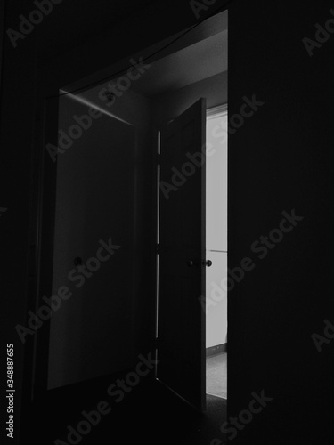 Interior Of Dark Room At Home With Open Door Canvas Print