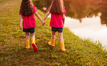Unrecognizable Sisters Walking...