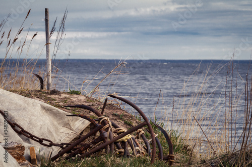 anchors for fishing nets on the shore of Lake Ladoga, Leningrad region, Russia Slika na platnu