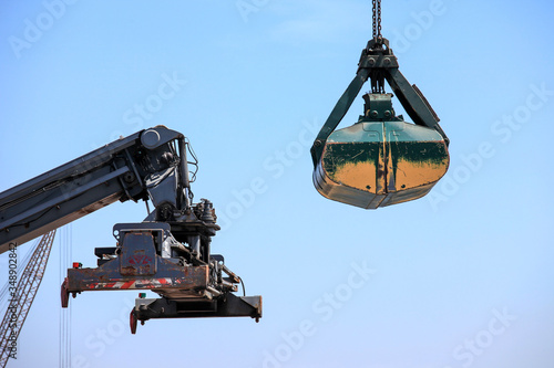 Large Container handler and Clamshell bucket at a local port. Fototapet