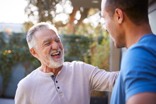 Senior Hispanic Man Talking An...
