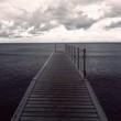 Wooden Pier In Sea Against Sky