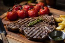 T-bone Steak With Baked Tomato...