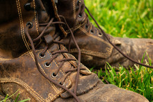 Old Leather Boots In The Grass