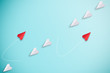 canvas print picture - Red paper plane out of line with white paper to change disrupt and finding new normal way on blue background. Lift and business creativity new idea to discovery innovation technology.