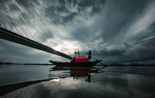 Boat On A River Under The Monsoon Sky In Kolkata