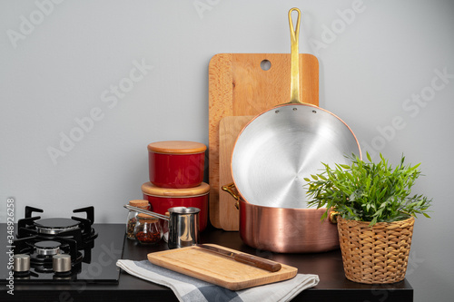 Kitchen counter with copper pots, gas stove and kitchen utensils Canvas Print