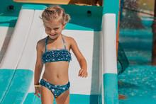 Happy Little Girl Splashing Ar...