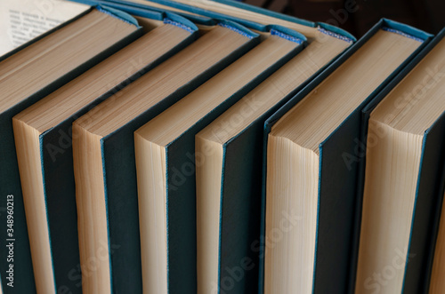 A collection of old hardback books. Fototapeta