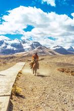 Incognito Rider On Horseback En Route To The Pastoruri Glacier, In The Huascarán National Park, Huaraz / Peru. Tropical Glacier At 5200 Meters Above Sea Level.