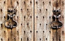 Old Knockers On Wooden Door