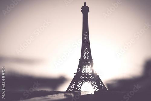 Obraz na plátně Replica Of Silhouette Eiffel Tower On Table