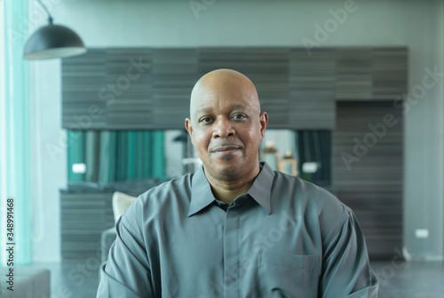 Valokuvatapetti Portrait of smiling business black man person working from home and talking to h