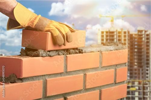 Fototapeta Bricklayer build cement masonry layer obraz