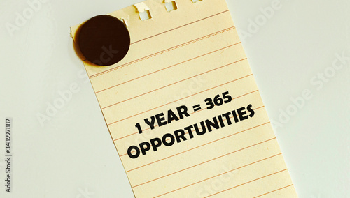 Fotografering 1 year 365 opportunities Piece of yellow paper taped to a refrigerator door
