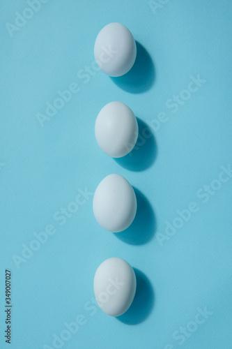 Valokuvatapetti Four white eggs lie exactly in a row