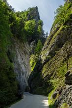 Curvy Road Between Steep Rocks...