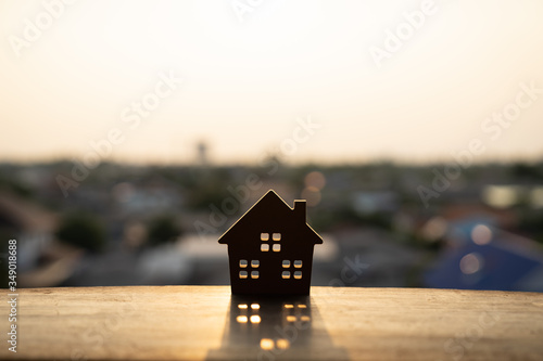 House model on wood table. Real estate agent offer house, property insurance and security, affordable housing concepts