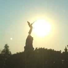 Scenic View Of Silhouette Angel Statue Against Sun