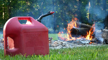 Gasoline Can In Front Of A Fire, Fire Hazard, Burning Hazard,