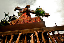Low Angle View Of Hands Carrying Jesus Christ Statue During Black Nazarene