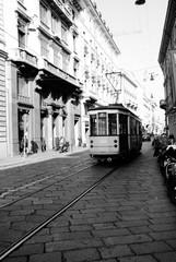 Cable Car On City Street Amidst Buildings