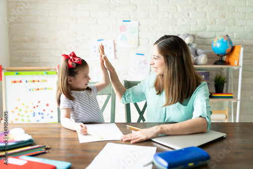 Fotografiet Mom and girl enjoying homeschool together