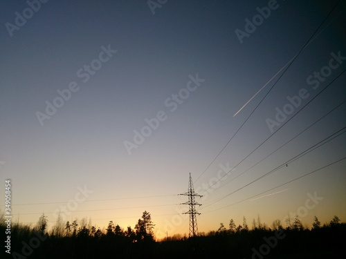 Fototapeta Low Angle View Of Electricity Pylon Against Clear Sky During Sunset